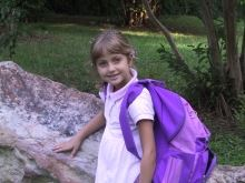 Girl Smiling with Purple Backpack